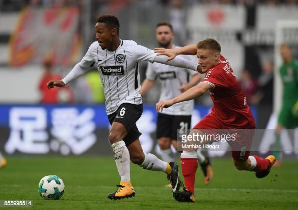 Jonathan de Guzman of Frankfurt is challenged by Santiago Ascacibar of Stuttgart during the Bundesliga match between Eintracht Frankfurt and VfB...
