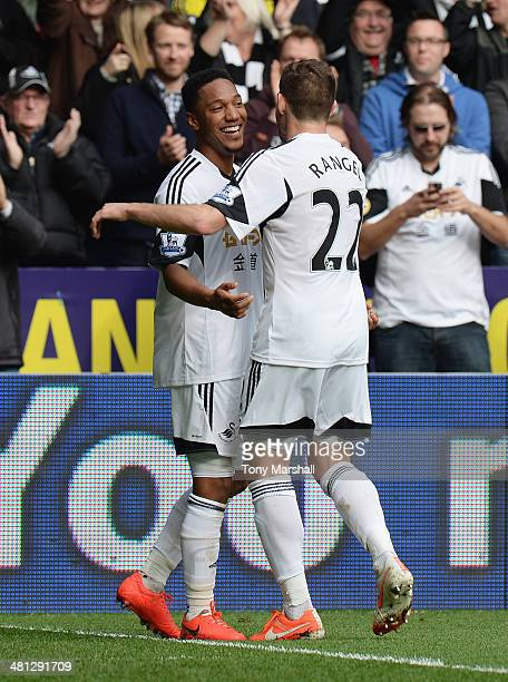 Jonathan de Guzman of Swansea City celebrates his second goal with Angel Rangel of Swansea City during the Barclays Premier League match between...