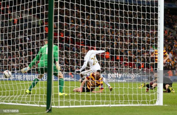Jonathan de Guzman of Swansea City scores their fifth goal during the Capital One Cup Final match between Bradford City and Swansea City at Wembley...