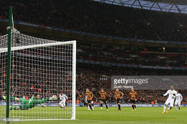 Jonathan de Guzman of Swansea City scores their fourth goal from the penalty spot during the Capital One Cup Final match between Bradford City and...