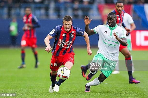 Jonathan Delaplace of Caen and Henri Saivet of SaintEtienne during the Ligue 1 match between SM Caen and AS SaintEtienne at Stade Michel D'Ornano on...