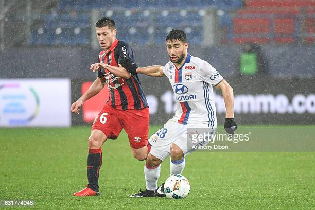 Jonathan Delaplace of Caen and Nabil Fekir of Lyon during the Ligue 1 match between SM Caen and Olympique Lyonnais Lyon at Stade Michel D'Ornano on...