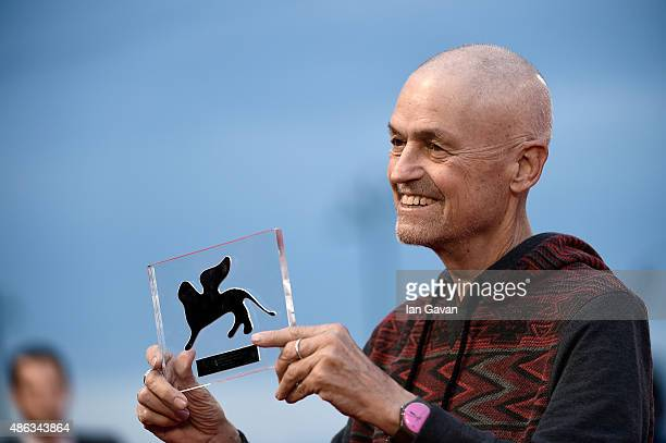 Jonathan Demme poses with his Visionary Talent Award attends a premiere for 'Spotlight' during the 72nd Venice Film Festival at Sala Grande on...