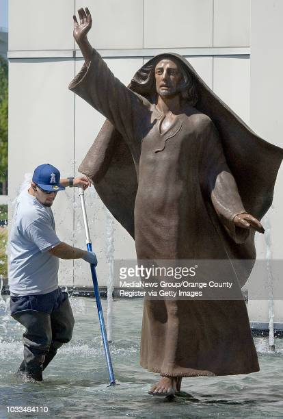 Jonathan Diaz has one of the coolest jobs in Orange County as he walks in water while cleaning a fountain at Christ Cathedral. The church, formally...