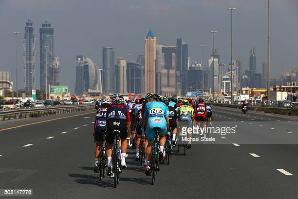 Jonathan Dibben of Team Wiggins chats to Lars Boom of Astana Pro Team as the peloton heads through Dubai during the Dubai Silicon Oasis Stage One of...