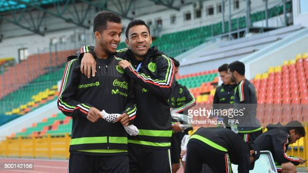 Jonathan dos Santos and Marco Fabian share a joke during the Mexico training session on June 23 2017 in Kazan Russia