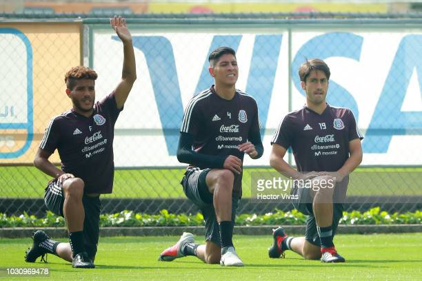 Jonathan Dos Santos Edson Alvarez and Jose Abella of Mexico warm up during Mexico National Team training session ahead of the international friendly...