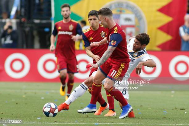 Jonathan dos Santos of Los Angeles Galaxy and Albert Rusnak of Real Salt Lake fight for control of the ball during the first half of a game at...