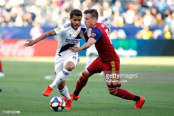 Jonathan dos Santos of Los Angeles Galaxy and Corey Baird of Real Salt Lake fight for control of the ball during a game at Dignity Health Sports Park...