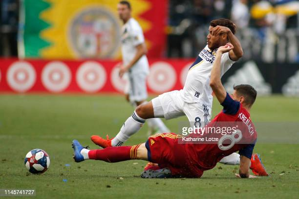 Jonathan dos Santos of Los Angeles Galaxy and Damir Kreilach of Real Salt Lake fight for control of the ball during the second half of a game at...