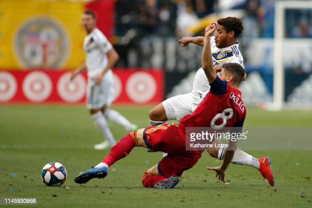 Jonathan dos Santos of Los Angeles Galaxy and Damir Kreilach of Real Salt Lake fight for control of the ball during a game at Dignity Health Sports...