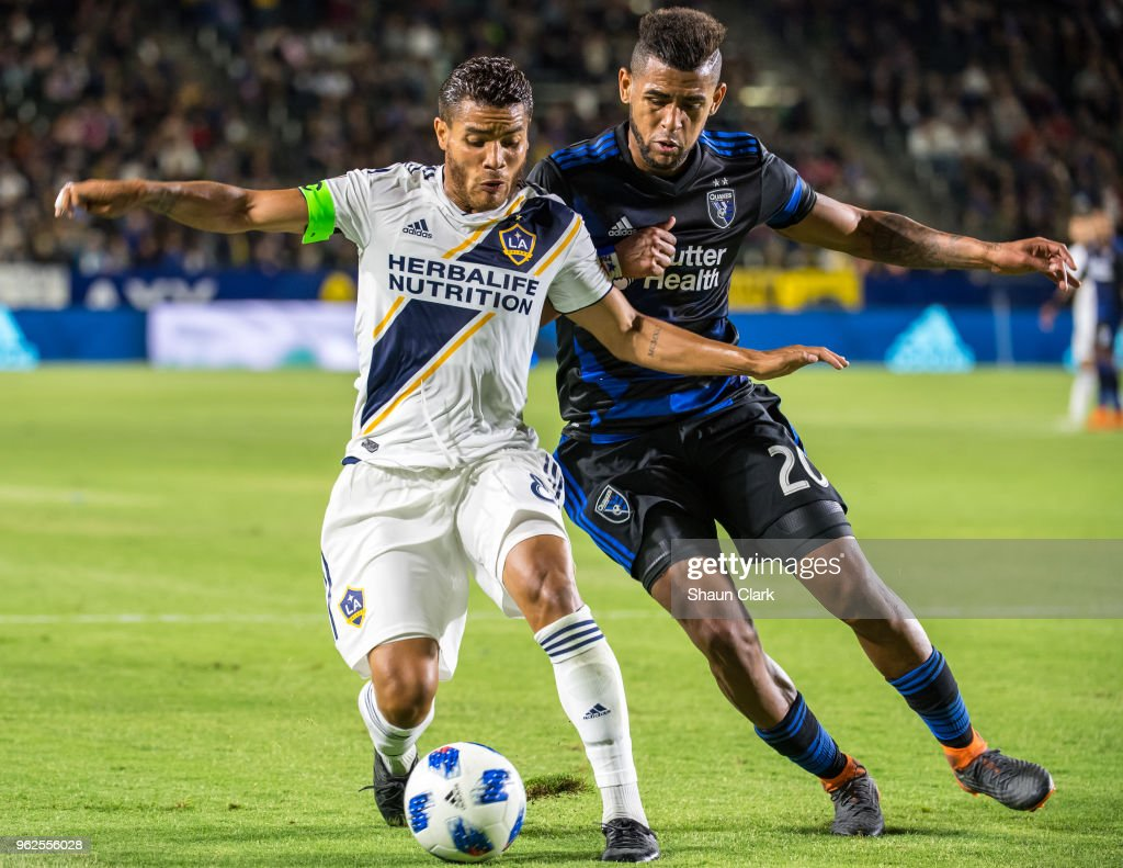 Jonathan dos Santos #8 of Los Angeles Galaxy battles Anibal Godoy #20 of San Jose Earthquakes during the Los Angeles Galaxy's MLS match against San Jose Earthquakes at the StubHub Center on May 25, 2018 in Carson, California. The Los Angeles Galaxy won the match 1-0