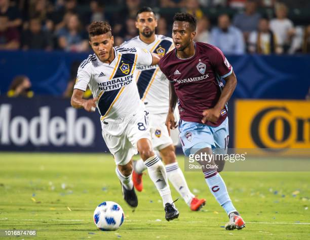 Jonathan dos Santos of Los Angeles Galaxy battles Kellyn Acosta of Colorado Rapids during the Los Angeles Galaxy's MLS match against Colorado Rapids...