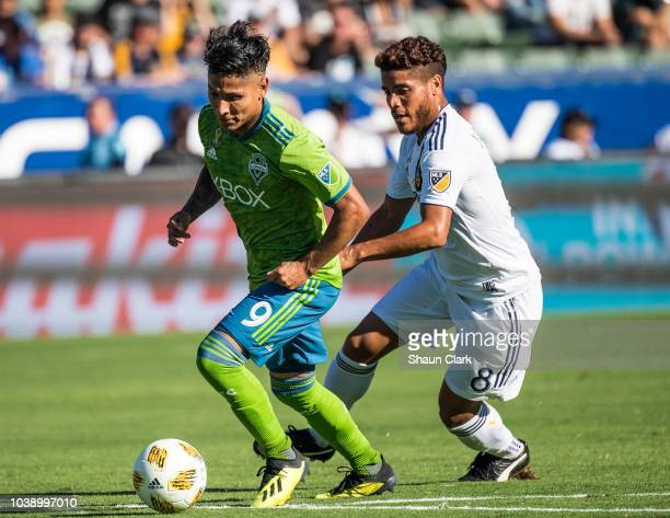 Jonathan dos Santos of Los Angeles Galaxy battles Raul Ruidiaz of Seattle Sounders during the Los Angeles Galaxy's MLS match against Seattle Sounders...