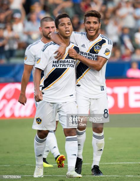 Jonathan dos Santos of Los Angeles Galaxy congratulates his brother Giovani dos Santos on his goal against Orlando City SC at the StubHub Center on...