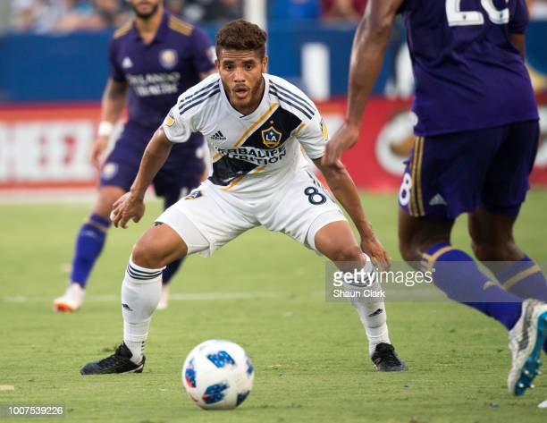 Jonathan dos Santos of Los Angeles Galaxy defends against Orlando City SC at the StubHub Center on July 29 2018 in Carson California Los Angeles...