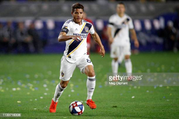 Jonathan dos Santos of Los Angeles Galaxy handles the ball in the game against the Chicago Fire at Dignity Health Sports Park on March 02, 2019 in...