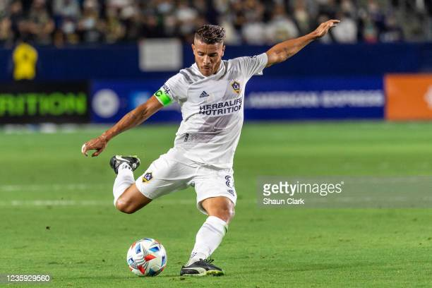 Jonathan dos Santos of Los Angeles Galaxy kicks the ball during the game against Portland Timbers at the Dignity Health Sports Park on October 16,...