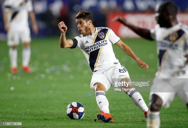Jonathan dos Santos of Los Angeles Galaxy slips during the game against the Chicago Fire at Dignity Health Sports Park on March 02, 2019 in Carson,...
