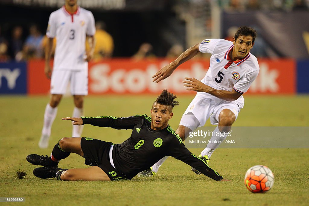 Jonathan Dos Santos of Mexico and Celso Borges of Costa Rica during the Gold Cup Quarter Final between Mexico and Costa Rica at MetLife Stadium on July 19, 2015 in East Rutherford, New Jersey.