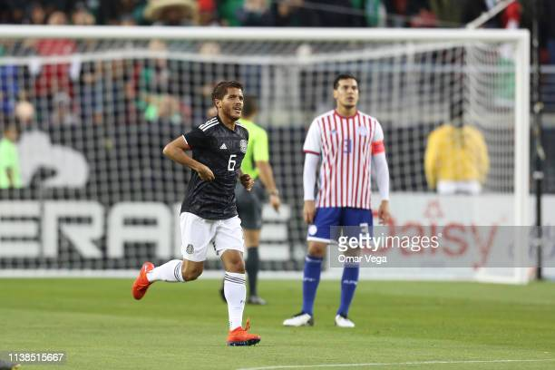 Jonathan Dos Santos of Mexico celebrates after scoring the first goal of his team during the friendly match between Paraguay and Mexico at Levi's...