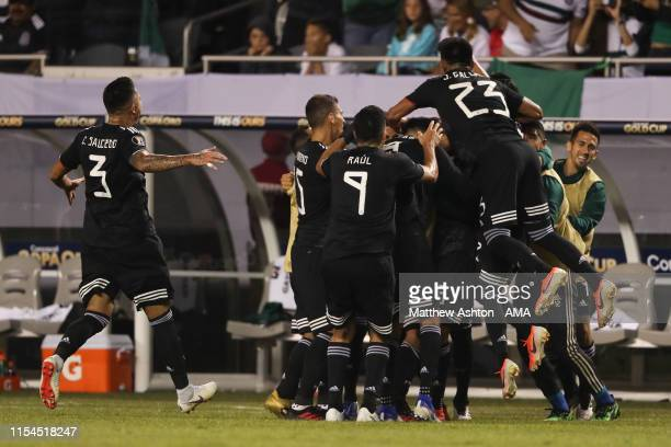 Jonathan dos Santos of Mexico celebrates with his teammates after scoring a goal to make it 1-0 during the 2019 CONCACAF Gold Cup Final between...