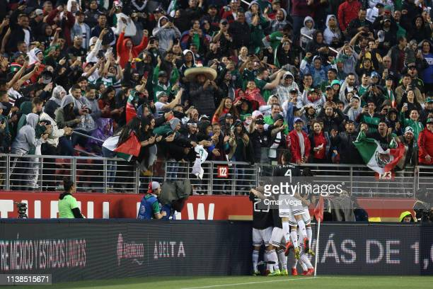 Jonathan Dos Santos of Mexico celebrates with teammates after scoring the first goal of his team during the friendly match between Paraguay and...