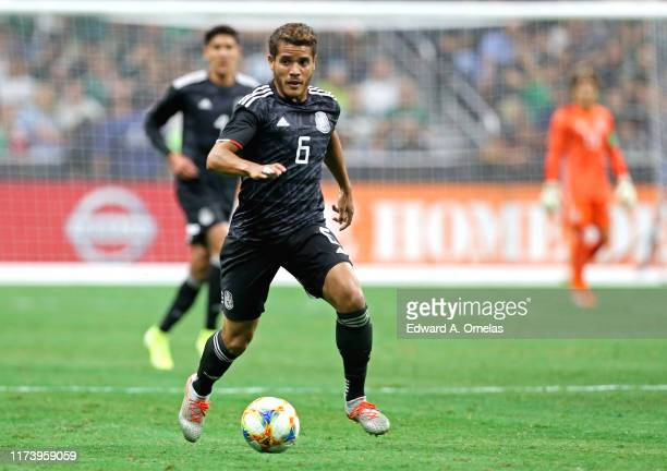Jonathan Dos Santos of Mexico heads up field against Argentina during their International Friendly soccer match at the Alamodome on September 10,...