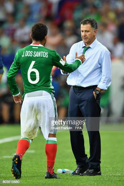 Jonathan Dos Santos of Mexico shakes hands with head coach Juan Carlos Osorio after substituted during the FIFA Confederations Cup Russia 2017...