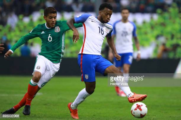 Jonathan Dos Santos of Mexico struggles for the ball with Kellyn Acosta of US during the match between Mexico and The United States as part of the...