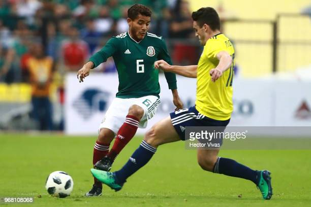 Jonathan dos Santos of Mexico struggles for the ball with Kenny Mclean of Scotland during the International Friendly match between Mexico v Scotland...
