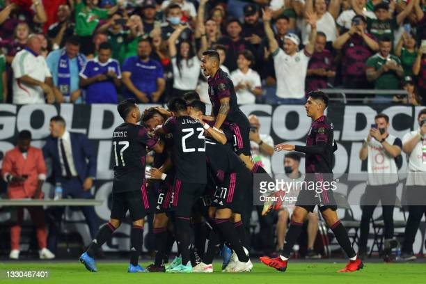 Jonathan Dos Santos of Mexicocelebrates with his teammates after scoring his team's second goal during to the a quarterfinal match between Mexico...