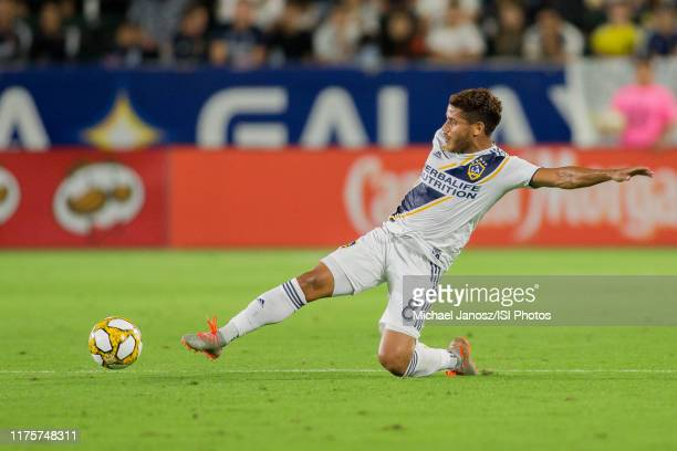 Jonathan dos Santos of the Los Angeles Galaxy gets after a loose ball during a game between Sporting Kansas City and Los Angeles Galaxy at Dignity...