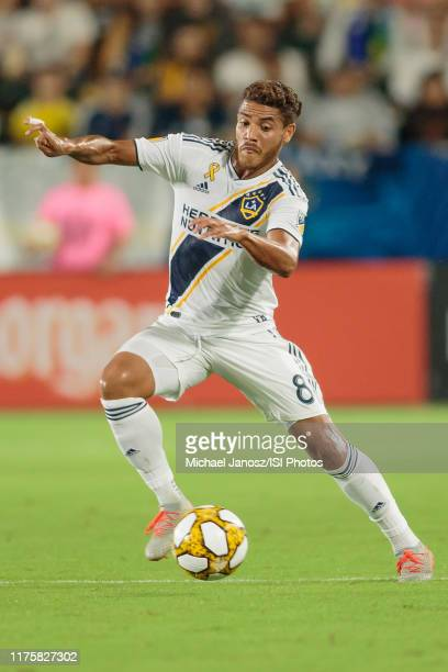 Jonathan dos Santos of the Los Angeles Galaxy moves with the ball during a game between Sporting Kansas City and Los Angeles Galaxy at Dignity Health...