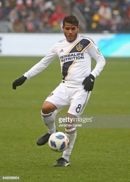 Jonathan dos Santos of the Los Angeles Galaxy passes against the Chicago Fire at Toyota Park on April 14 2018 in Bridgeview Illinois The Galaxy...