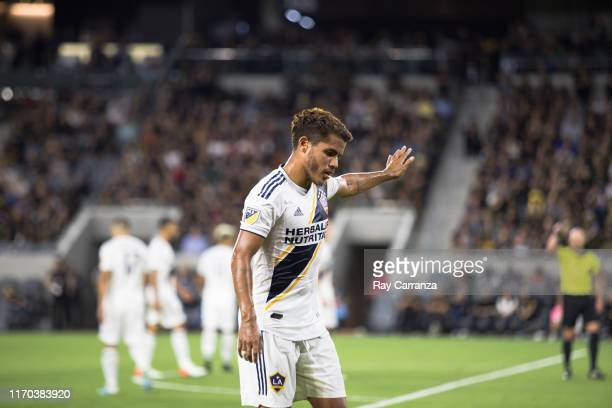 Jonathan dos Santos of the Los Angeles Galaxy walking to the corner flag at Banc of California Stadium on August 25, 2019 in Los Angeles, California.
