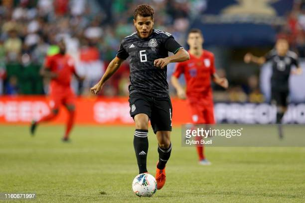 Jonathan dos Santos of the Mexico dribbles the ball in the first half against the United States during the 2019 CONCACAF Gold Cup Final at Soldier...