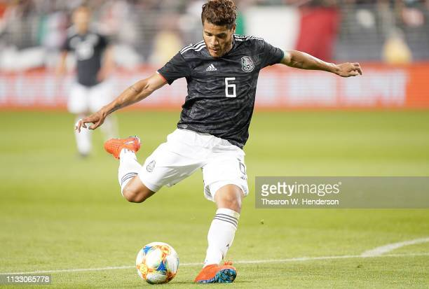 Jonathan Dos Santos of the Mexico National team shoots on goal against Paraguay during the second half of their soccer game at Levi's Stadium on...