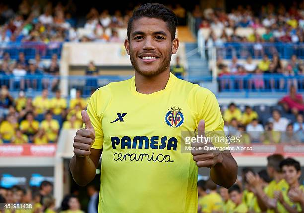 Jonathan Dos Santos poses during his presentation as a new player for Villarreal CF at the El Madrigal stadium on July 10, 2014 in Villarreal, Spain.