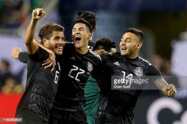 Jonathan dos Santos, Uriel Antuna, and Alexis Vega of the Mexico celebrate after beating the United States 1-0 in the 2019 CONCACAF Gold Cup Final at...