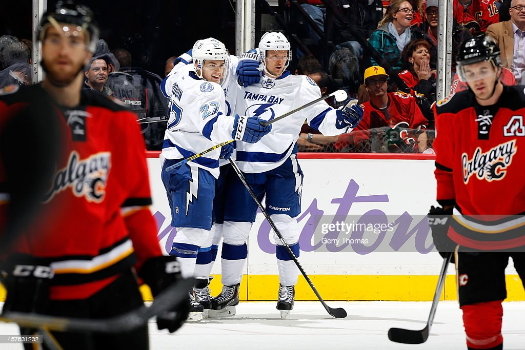 Jonathan Drouin #27 and Anton Stralman #6 of the Tampa Bay Lightning celebrate a goal against the Calgary Flames at Scotiabank Saddledome on October 21, 2014 in Calgary, Alberta, Canada.