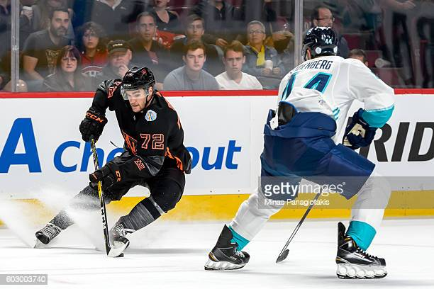Jonathan Drouin of Team North America puts on the breaks in front of Dennis Seidenberg of Team Europe during the pretournament World Cup of Hockey...