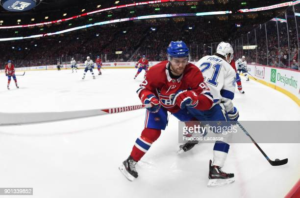 Jonathan Drouin of the Montreal Canadiens and Brayden Point of the Tampa Bay Lightning fight for the puck in the NHL game at the Bell Centre on...