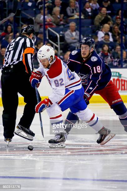 Jonathan Drouin of the Montreal Canadiens beats PierreLuc Dubois of the Columbus Blue Jackets for a faceoff win during the game on March 12 2018 at...