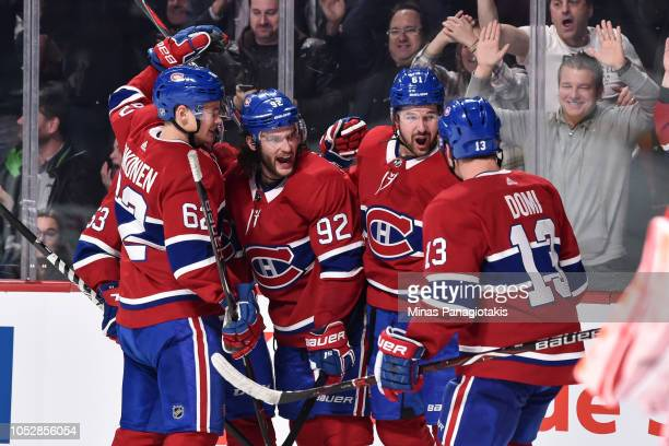 Jonathan Drouin of the Montreal Canadiens celebrates his second period goal with teammates against the Calgary Flames during the NHL game at the Bell...