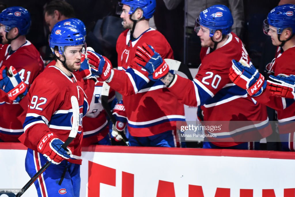 Jonathan Drouin #92 of the Montreal Canadiens celebrates his third period goal with teammates on the bench against the Nashville Predators during the NHL game at the Bell Centre on February 10, 2018 in Montreal, Quebec, Canada. The Nashville Predators defeated the Montreal Canadiens 3-2 in a shootout.