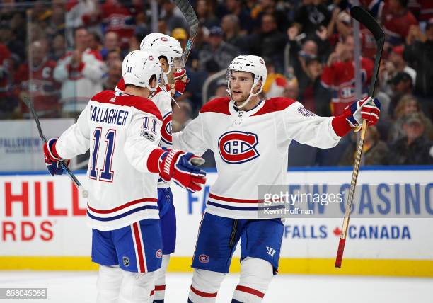 Jonathan Drouin of the Montreal Canadiens celebrates with Brendan Gallagher and Max Pacioretty who score a goal during the first period against the...