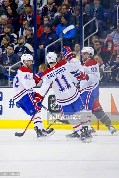 Jonathan Drouin of the Montreal Canadiens is congratulated by Brendan Gallagher of the Montreal Canadiens and Paul Byron of the Montreal Canadiens...
