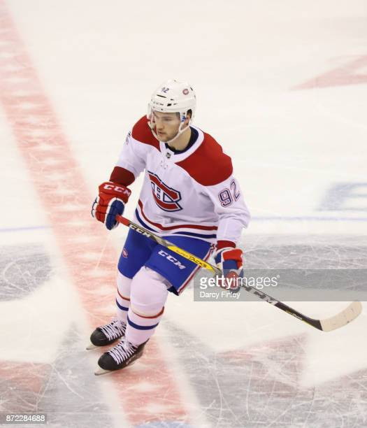 Jonathan Drouin of the Montreal Canadiens keeps an eye on the play during third period action against the Winnipeg Jets at the Bell MTS Place on...