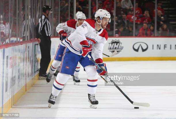 Jonathan Drouin of the Montreal Canadiens plays the puck against the New Jersey Devils at Prudential Center on March 6 2018 in Newark New Jersey